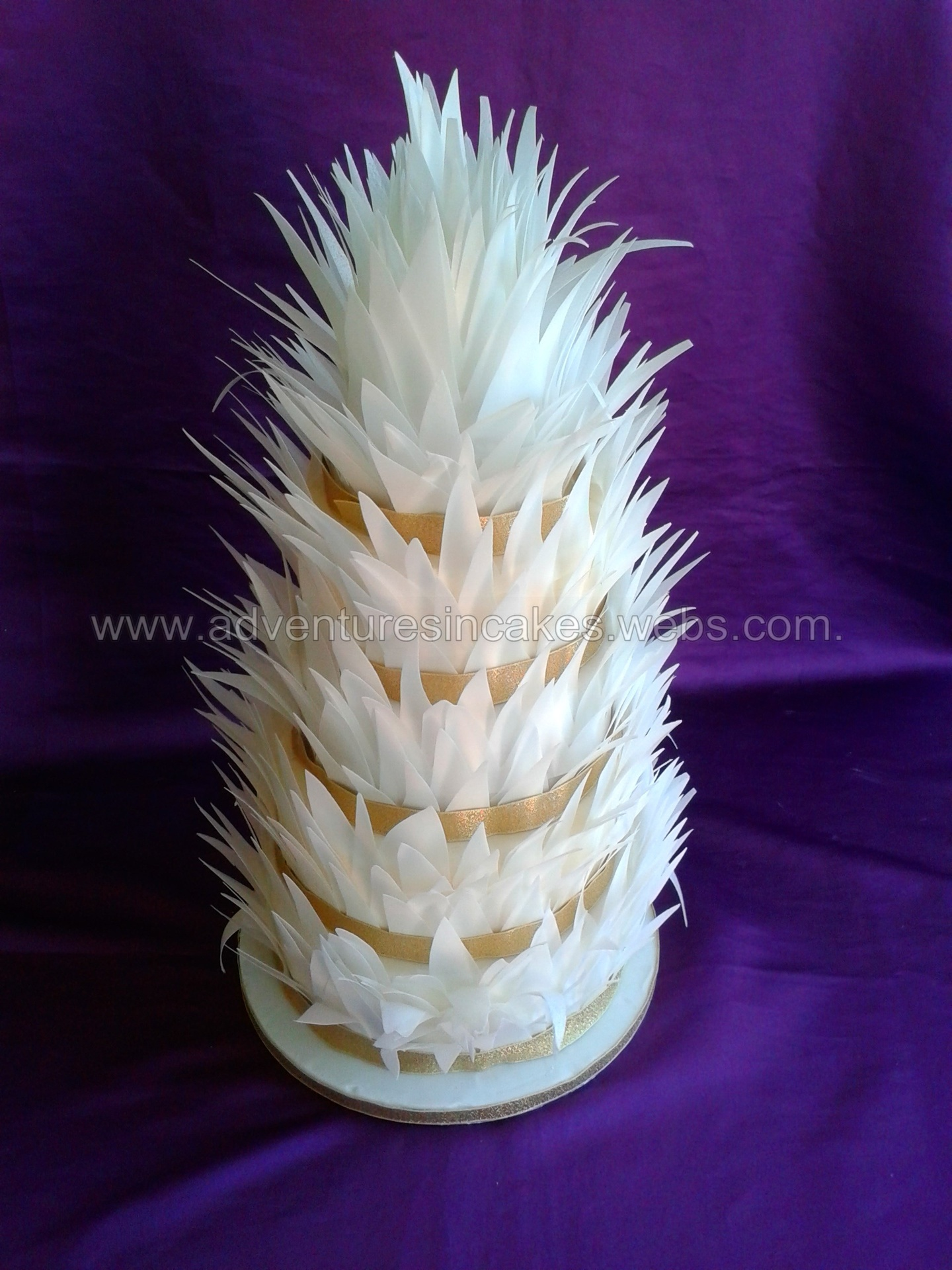 rice paper feather wedding cake 5 tier wedding cake spikey feathers made from edible rice 19224